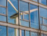Reflection of a wind turbine in an office window